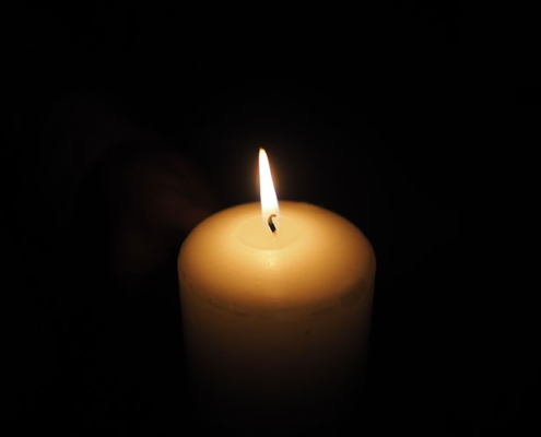 Candle against a dark background